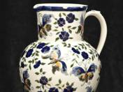 Zsolnay jug decorated with butterfly and flower decor