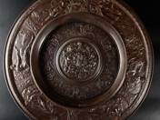 Historical cast iron plate with month allegory