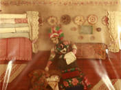 Palóc doll-room textile picture - Mother lulling a cradle