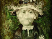 Man in Hat with a Flower