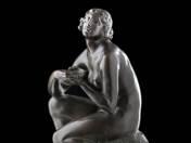 Squatting nude